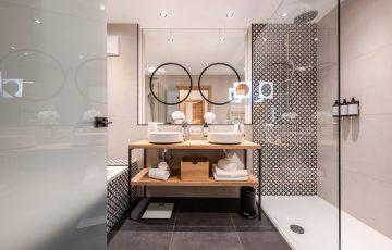 Umgerüstetes Badezimmer im Naturhotel Forsthofgut Leogang - ab sofort wird hier Wasser gespart